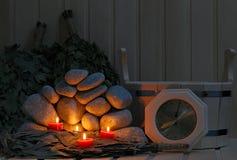 Stearinljus, stenar för bastu och bad Royaltyfri Fotografi