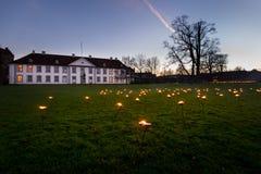 1000 stearinljus varje dag i december på den Odense slotten Arkivfoto