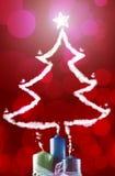 Stearinljuslampa och jultree Royaltyfria Bilder