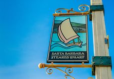 Stearn`s Wharf welcome banner on metal pole. Stearn`s Wharf welcome banner on a metal street pole in Santa Barbara, California with copy space Stock Photos