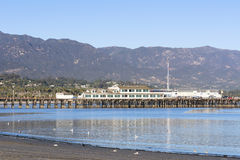 Stearns Wharf in Santa Barbara. A view of historic Stearns Wharf framed against the mountains of Santa Barbara, California royalty free stock image