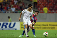 Steaua Bucharest- Aktobe. Cornel Rapa fighting for the ball, during the football match between Steaua Bucharest and Aktobe, 6th August 2014, National Arena Royalty Free Stock Images