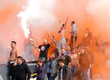 Steaua Bucharest footbal fans cheering with smoke bombs Royalty Free Stock Images