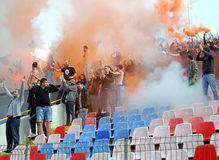 Steaua Bucharest footbal fans cheering with smoke bombs Royalty Free Stock Photography