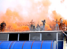 Steaua Bucharest footbal fans cheering with smoke bombs Royalty Free Stock Image