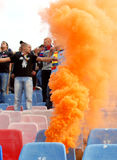 Steaua Bucharest footbal fans cheering with smoke bombs Stock Photo