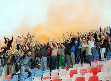 Steaua Bucharest footbal fans cheering with smoke bombs Stock Photography