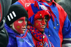 FC Steaua Bucharest- FC Gaz Metan Medias. Steaua Bucharest young supporters with painted faces, during the football match, counting for the Romanian League One Royalty Free Stock Photography