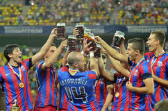 Steaua Players celebrating victory with beer Royalty Free Stock Image