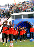 Steaua players react while Steaua Bucharest footbal fans cheer w Stock Photo