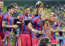 Steaua Players throw beer on Iasmin Latovlevici Royalty Free Stock Image