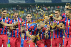 Steaua Players throw beer on Iasmin Latovlevici Stock Photography