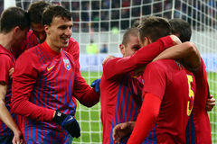 FC Steaua Bucharest- FC Gaz Metan Medias. Steaua ucharest players cheering after scoring a goal, during the football match, counting for the Romanian League One Royalty Free Stock Photo