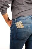 Stecken Sie Geld ein Stockfoto