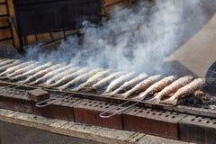 Steckerlfisch - gegrillter Fisch Stockbild