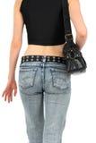 Stedelijke vrouw in jeans, met handtas Royalty-vrije Stock Foto