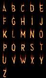 Steek alfabet in brand Royalty-vrije Stock Afbeeldingen