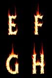 Steek Brieven E, F, G, H in brand Stock Fotografie