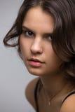 Steek het gezicht van een vrouw aan Royalty-vrije Stock Foto