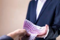 Steekpenning en corruptie met euro bankbiljetten royalty-vrije stock afbeeldingen
