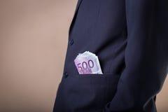 Steekpenning en corruptie met euro bankbiljetten stock foto's