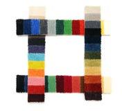 Steekproeven van een tapijt Stock Foto's