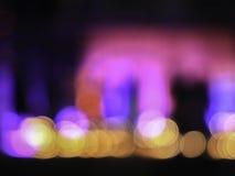 Steekt de onduidelijk beeld abstracte nacht bokeh aan Stock Foto's