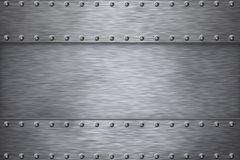 Steel. Rivets on brushed steel background Royalty Free Stock Photography