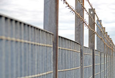 Steel anti entry fence with sharp spikes Stock Photo