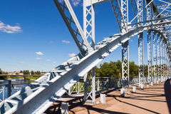 Steel arch bridge across river Msta. Novgorod region, Stock Photo