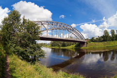 Steel Arch Bridge on river Msta Royalty Free Stock Photos