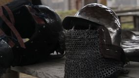 Steel armour and helmet with chain mail facemask prepared by warrior for Crusade. Stock footage stock video footage