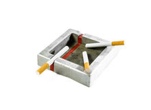 Steel ashtray and cigarette isolated Royalty Free Stock Photography