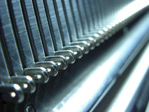 Steel background. Macrofilming of the knitting machine in house conditions Royalty Free Stock Images