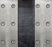 Steel background with bolts. Background metals used in industry Stock Images