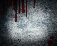 Steel background with drop of blood. Steel background with red drop of blood Royalty Free Stock Photo