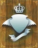 Steel badge with wings and crown Royalty Free Stock Photos