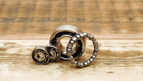 Steel ball bearings. On wooden table. space for your text royalty free stock photography