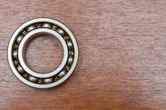 Steel ball bearings on wooden table Stock Image