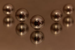 Steel balls on a mirror Royalty Free Stock Image
