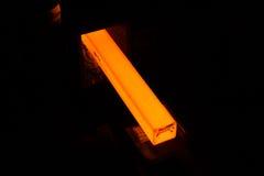 Steel bar. Glowing steel bar inside steel factory Royalty Free Stock Images