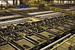 Steel bar handling machinery. Royalty Free Stock Images