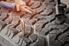 Car tire. Steel bar puncture car tire Royalty Free Stock Photos