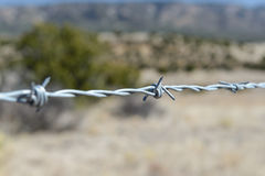 Steel barbed wire protecting trespass. Close up steel barbwire to stop trespassing the land stock photo