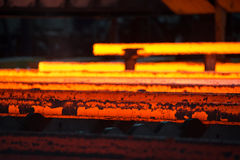Steel bars just after casting Stock Photos