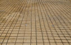 Steel bars mesh reinforcement before pouring concrete Royalty Free Stock Images