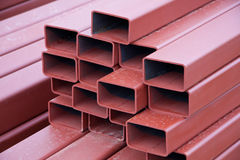 Steel Beams. A stack of painted steel box girders used in construction Stock Image