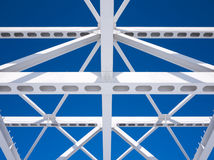 Steel beams against the blue sky Stock Photos