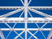 Steel beams against the blue sky Stock Photos