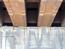 Steel beams on concrete rusting view under car road bridge in Indianapolis Indiana. USA Royalty Free Stock Photo